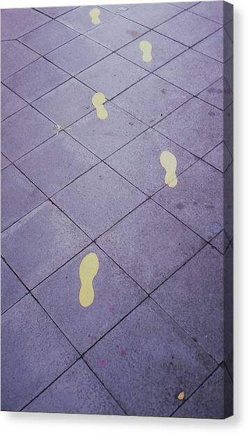 Footsteps On The Street Canvas Print