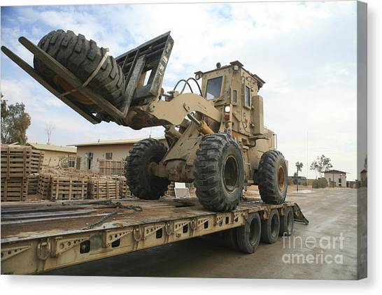 Forklifts Canvas Print - Forklift Is Unloaded Off Of A Logistics by Stocktrek Images