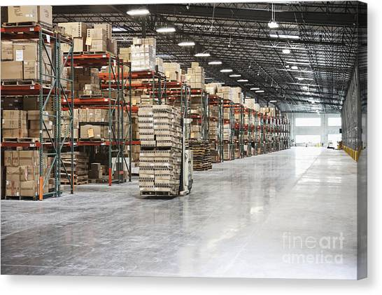 Forklifts Canvas Print - Forklift Moving Product In A Warehouse by Jetta Productions, Inc