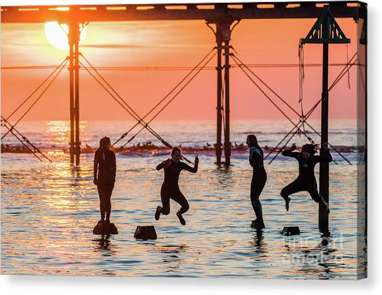 Four Girls Jumping Into The Sea At Sunset Canvas Print