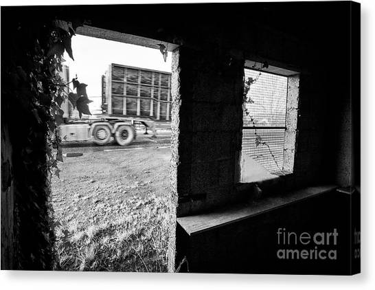 Brexit Canvas Print - freight traffic passing disused old Irish Customs post on the irish border by Joe Fox