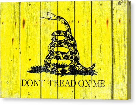 Gadsden Flag On Old Wood Planks Canvas Print