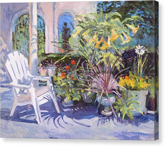 Garden Chair In The Patio Canvas Print