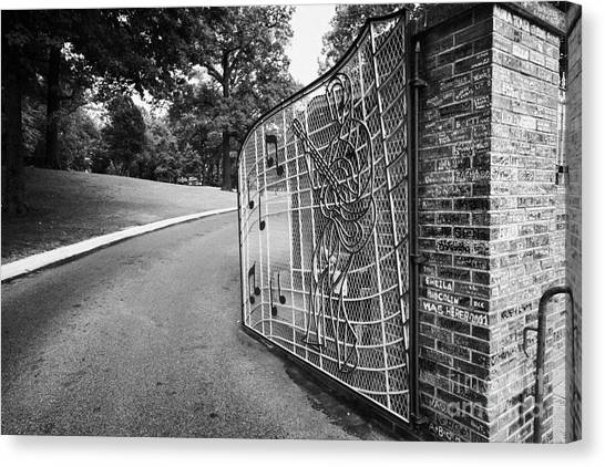 Driveway Canvas Print - Gate And Driveway Of Graceland Elvis Presleys Mansion Home In Memphis Tennessee Usa by Joe Fox