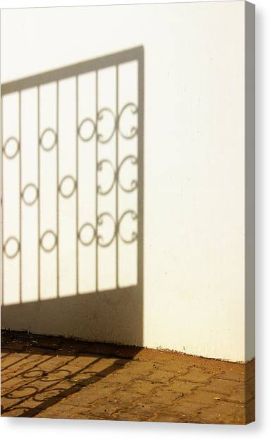 Gate Shadow Canvas Print