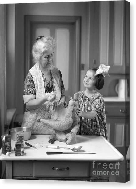 Stuffing Canvas Print - Girl Helping Grandmother Stuff Turkey by H. Armstrong Roberts/ClassicStock