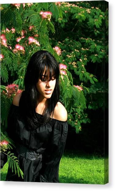 Girl With The Flower Tree Canvas Print by Maria Isabel Garcia