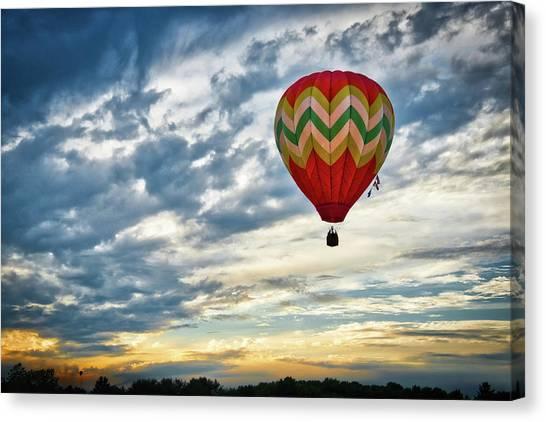 Gliding Through Sunset Canvas Print
