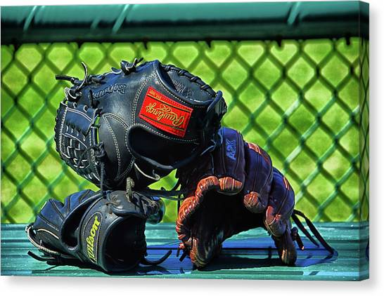 Atlantic 10 Canvas Print - Gloves On Dugout Bench by Mike Martin