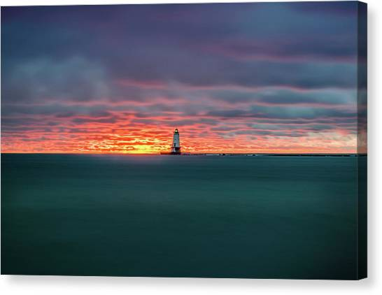 Glowing Sunset On Lake With Lighthouse Canvas Print