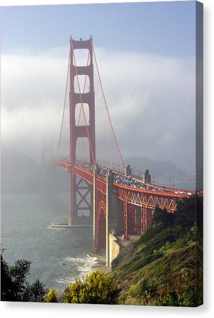 Golden Gate Bridge In The Fog Canvas Print by Mathew Lodge