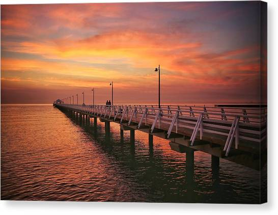 Golden Red Skies Over The Pier Canvas Print
