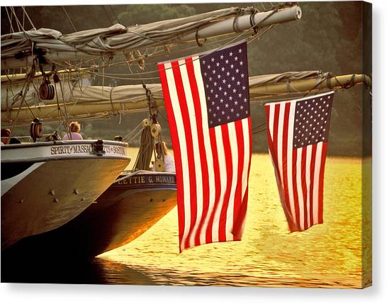 Golden Sunset And American Flags Canvas Print by Stephen Sisk