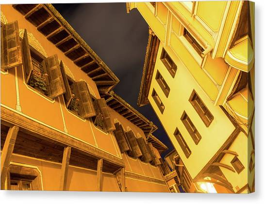 Golden Yellow Night - Chic Zigzags Of Oriel Windows And Serrated Roof Lines Canvas Print