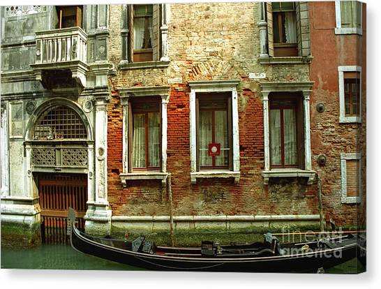 Gondola In Front Of House In Venice Canvas Print by Michael Henderson