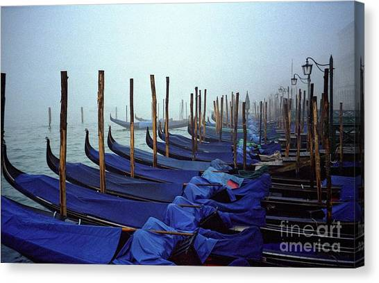 Gondolas In Venice In The Morning Canvas Print by Michael Henderson