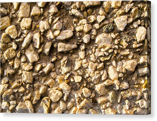 Gravel Stones On A Wall Canvas Print
