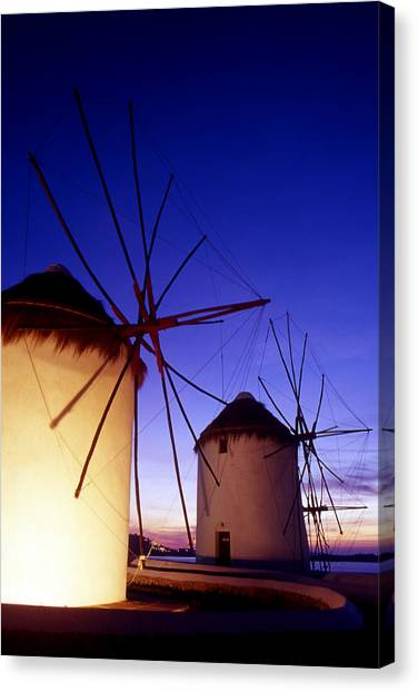 Greece. Mykonos Town. Illuminated Windmills At Dusk. Canvas Print by Steve Outram