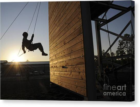 Green Berets Canvas Print - Green Beret Rappels Down A 50 Foot Wall by Stocktrek Images