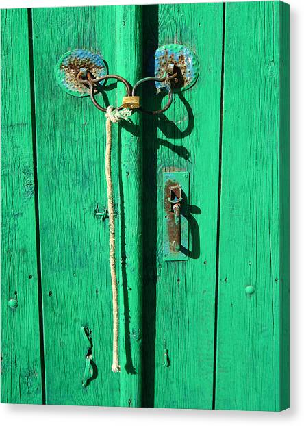 Green Door With Spectacles Canvas Print by Donald Buchanan