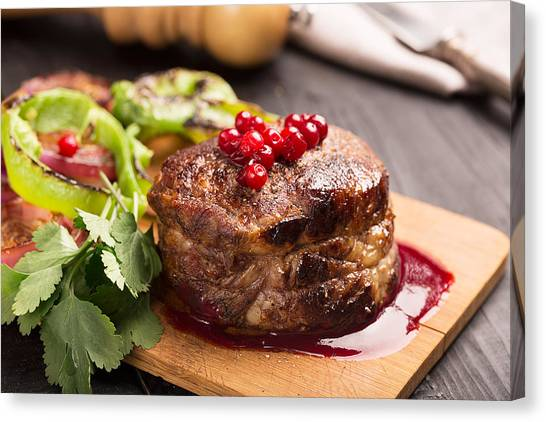 Cranberry Sauce Canvas Print - Grilled Steak Meat On The Wooden Surface by Vadim Goodwill