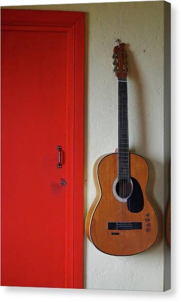 Guitar And Red Door Canvas Print