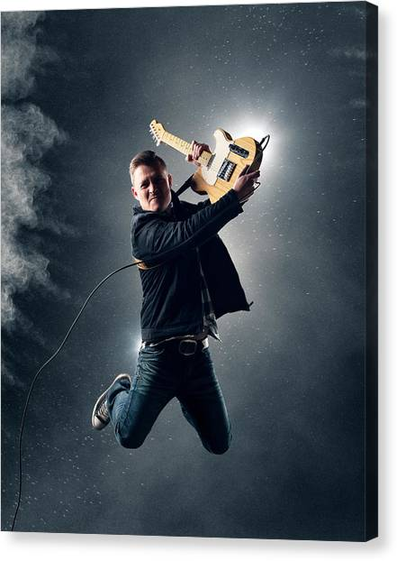 Electric Guitars Canvas Print - Guitarist Jumping High by Johan Swanepoel