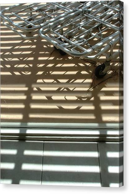 Gurneys Under A Pergola Through A Picture Window Canvas Print