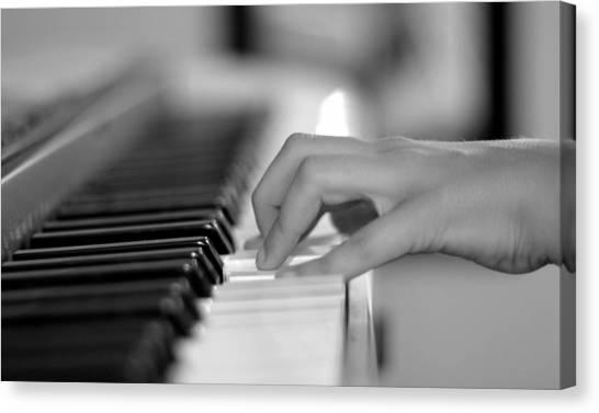 Hand On Piano Keyboard Canvas Print