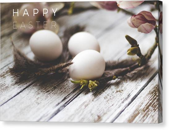 Easter Eggs Canvas Print - Happy Easter Card With Eggs And Magnolia On The Wooden Background by Aldona Pivoriene