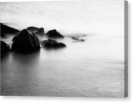 Harbor Rocks And Misty Ocean I Canvas Print by Charmian Vistaunet