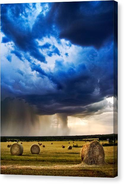 Hay Bales Canvas Print - Hay In The Storm by Eric Benjamin