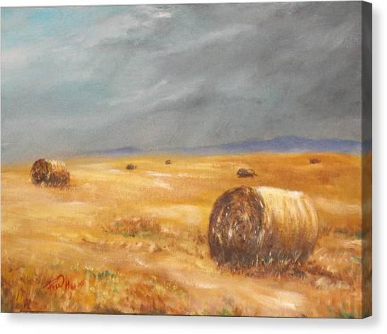 Haystacks After The Rain Canvas Print by Rusty W Hinshaw