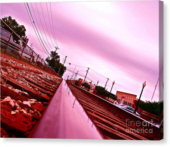 Head On The Tracks Canvas Print by Chuck Taylor