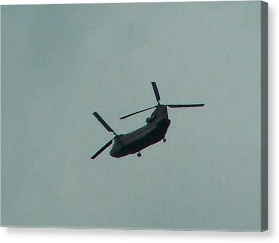 Helicopter Leaving Airport Canvas Print by Lila Mattison
