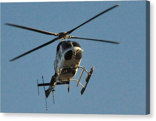 Helicopter On Final Approach  Canvas Print by Bill Perry