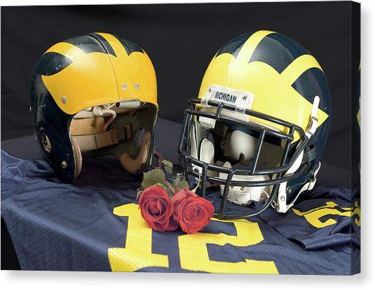 Helmets Of Different Eras With Jersey And Roses Canvas Print