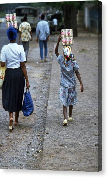 Water Travelpics Canvas Print - Helping Mum In Mozambique by Travel Pics
