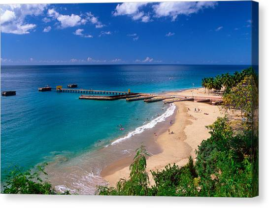 High Angle View Of A Pier On Crashboat Beach Puerto Rico. Canvas Print by George Oze