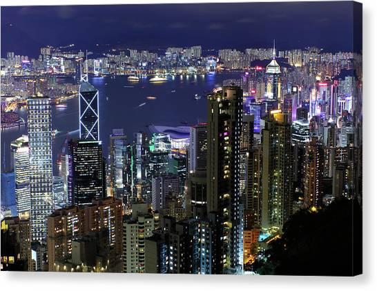 Hong Kong Canvas Print - Hong Kong At Night by Leung Cho Pan