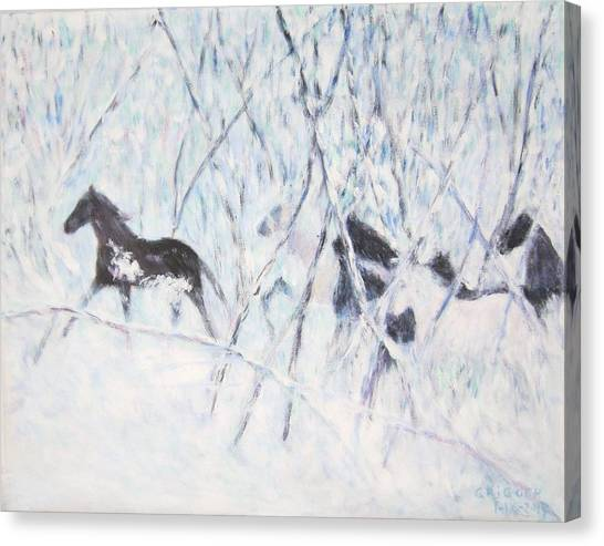 Horses Running In Ice And Snow Canvas Print