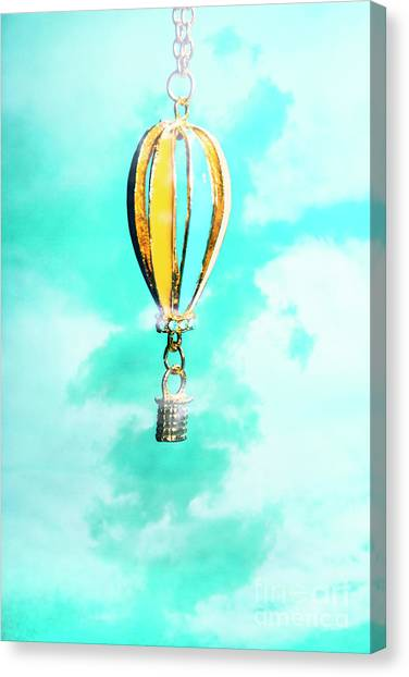 Balloons Canvas Print - Hot Air Balloon Pendant Over Cloudy Background by Jorgo Photography - Wall Art Gallery