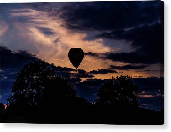 Canvas Print featuring the photograph Hot Air Balloon Silhouette At Dusk by Scott Lyons