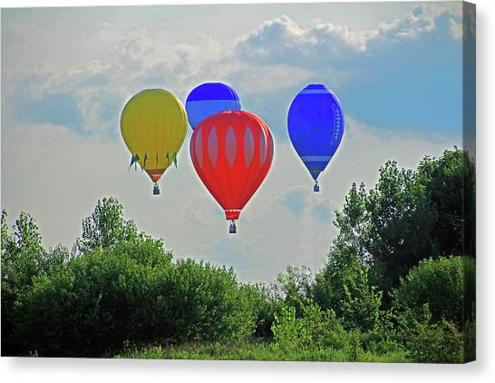 Canvas Print featuring the photograph Hot Air Balloons In The Sky by Angela Murdock