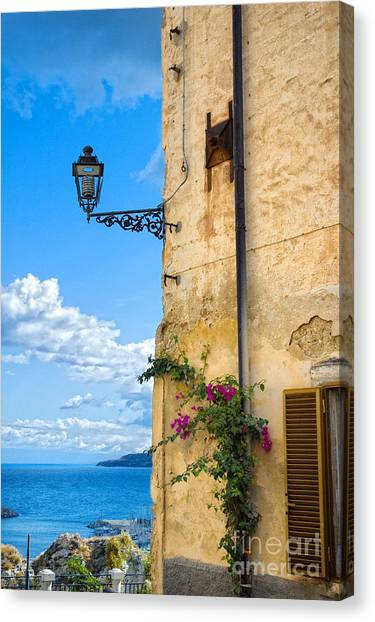 House With Bougainvillea Street Lamp And Distant Sea Canvas Print
