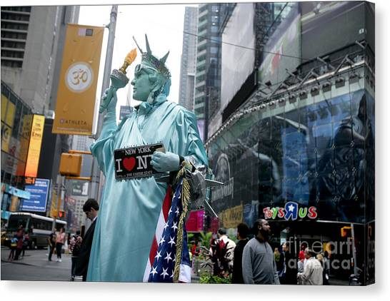 Human Statue Of Liberty In Times Square Canvas Print by Bruce Crummy