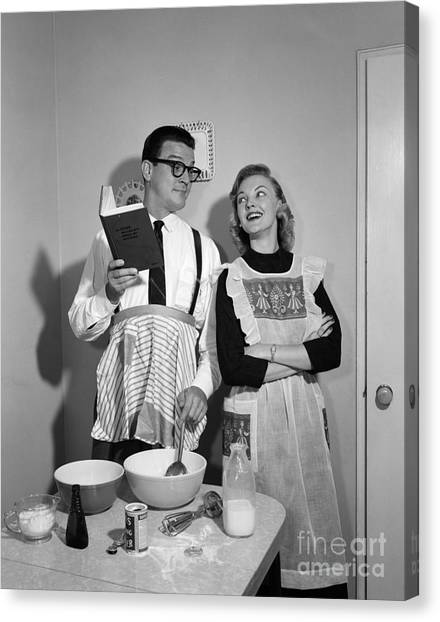 The Joy Of Life Canvas Print - Husband Trying To Cook While Wife Looks by Debrocke/ClassicStock