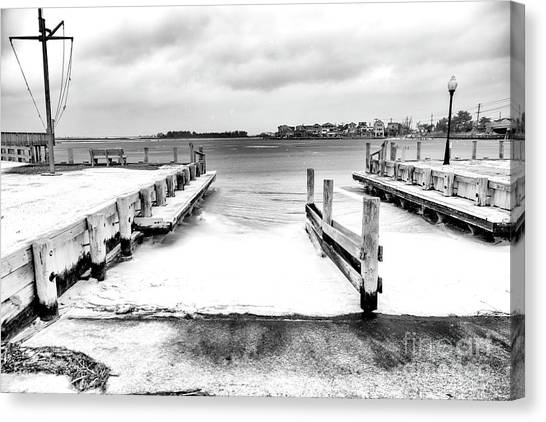Ice In The Bay At Long Beach Island Canvas Print by John Rizzuto