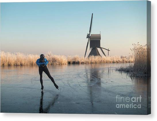 Ice Skating Past Frosted Reeds And A Windmill Canvas Print