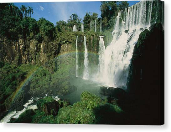 Iguazu Falls Canvas Print - Iguazu Waterfalls With A Rainbow by Roy Toft